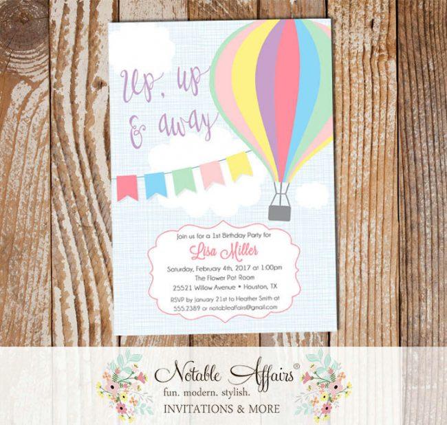 Pastel Pink Purple Mint Hot Air Balloon Birthday invitation on blue linen