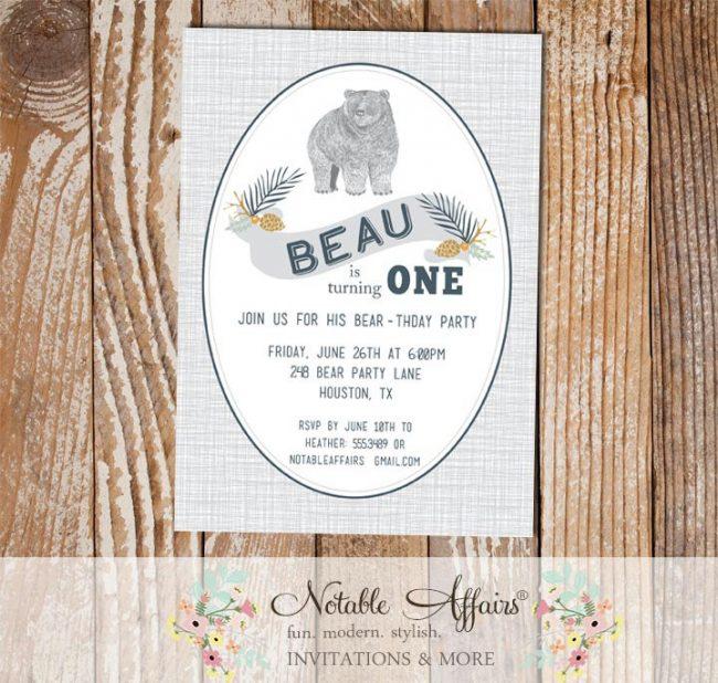 Woodland Rustic Bear Birthday Party invitation on gray linen background